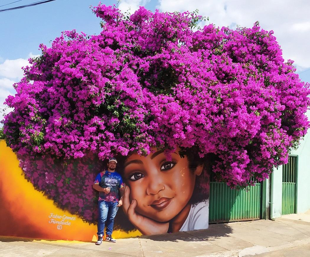 Meet The Brazilian Artist Behind The Viral Street Art Celebrating Black Women's Hair